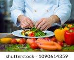 cook chef decorating garnishing ...   Shutterstock . vector #1090614359