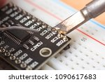 soldering some electronic... | Shutterstock . vector #1090617683