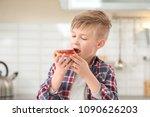Cute Little Boy Eating Tasty...