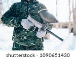 Small photo of Male paintball player, military game equipment