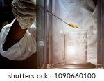 close up of hand wear glove is... | Shutterstock . vector #1090660100