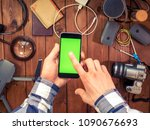 mobile phone in the hands on... | Shutterstock . vector #1090676693
