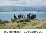 Small photo of Mana Island, New Zealand - April 22 2018: Guests on a tour of Mana Island scientific reserve.