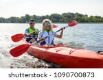 young happy couple paddling... | Shutterstock . vector #1090700873