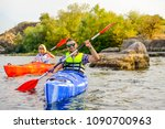 young happy couple paddling... | Shutterstock . vector #1090700963