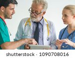 group  of doctor discussion... | Shutterstock . vector #1090708016