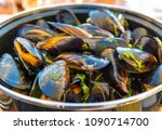 front view of a bowl of mussels ...   Shutterstock . vector #1090714700