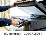 bussiness man hand press button ... | Shutterstock . vector #1090715054