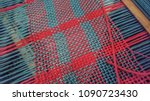 Small photo of Red and Teal Yarn Partly Woven on a Rigid Heddle Loom