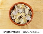 bowl with clams on a rustic...   Shutterstock . vector #1090736813