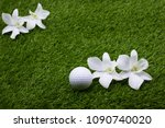 golf ball and white orchid are... | Shutterstock . vector #1090740020