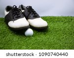 golf ball and shoes are on... | Shutterstock . vector #1090740440