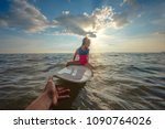 Small photo of girl is obstinacy and conviction in refused or decline a hand help to support playing surfboard in sea water