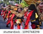 Small photo of Jakarta, Indonesia - May 13, 2018: The musical accompanist participated in the Parade of Pre 2018 Asian Games by using beautiful red, black and white costumes and golden yellow accessories