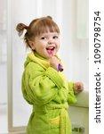 kid child girl brushing teeth... | Shutterstock . vector #1090798754