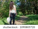 girl walking along a forest... | Shutterstock . vector #1090805720