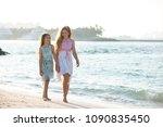 two teenagers girls walking... | Shutterstock . vector #1090835450