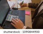 businessman using a calculator... | Shutterstock . vector #1090844900