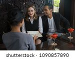 couple and receptionist at... | Shutterstock . vector #1090857890