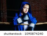 cute blond boy boxer with black ... | Shutterstock . vector #1090874240