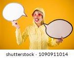 raincoat woman yellow...   Shutterstock . vector #1090911014