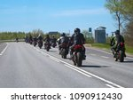 column of bikers riding on the... | Shutterstock . vector #1090912430