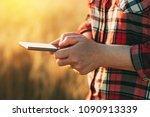 female farmer standing in ripe... | Shutterstock . vector #1090913339