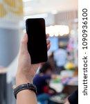 female hand's holding phone...   Shutterstock . vector #1090936100