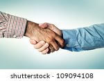 Business handshake, common greeting ritual for business agreement - stock photo