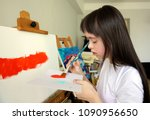 cute little girl is painting... | Shutterstock . vector #1090956650