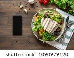 healthy chicken salad next to...   Shutterstock . vector #1090979120