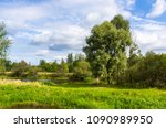 view on river in countryside at ... | Shutterstock . vector #1090989950