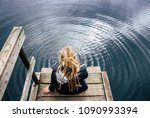 lonely young woman sitting by... | Shutterstock . vector #1090993394