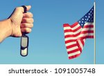 american flag and hand with... | Shutterstock . vector #1091005748