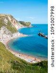 durdle door  dorset in uk ... | Shutterstock . vector #1091007998