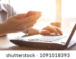 man holding credit card and... | Shutterstock . vector #1091018393