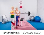 beautiful senior sportswomen... | Shutterstock . vector #1091034110