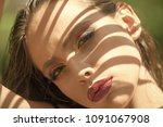 woman with shadow on face on...   Shutterstock . vector #1091067908