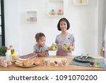 two little girl cooks in the... | Shutterstock . vector #1091070200
