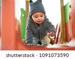 little boy having fun on a... | Shutterstock . vector #1091073590