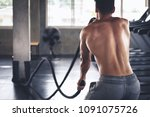fitness man doing exercise with ... | Shutterstock . vector #1091075726