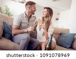 beautiful couple is drinking... | Shutterstock . vector #1091078969