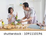 father and daughter cooks in... | Shutterstock . vector #1091110196