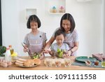 mother and daughter cooking in... | Shutterstock . vector #1091111558