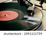 the stylus of the vinyl analog... | Shutterstock . vector #1091111759