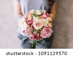 very nice young woman holding a ...   Shutterstock . vector #1091129570