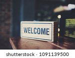"""A Wooden Sign Reads """"welcome""""..."""
