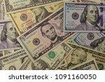 background of different dollar... | Shutterstock . vector #1091160050