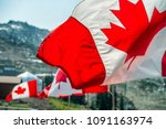 canada flags waving at the wind ... | Shutterstock . vector #1091163974