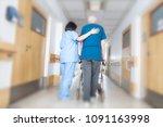 asian nurse helping elder man... | Shutterstock . vector #1091163998